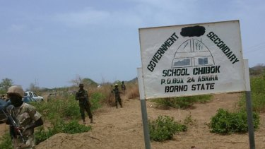 Soldiers stand guard the surroundings of the Government Girls Secondary School in Chibok in 2014.