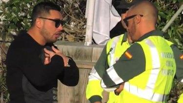 Salim Mehajer speaking to Spanish police on the island of Ibiza.