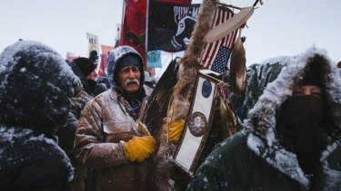 Glenn Scott, 60, a member of the Chippewa tribe and an army veteran, in amarch by more than  2000 veterans from the Oceti Sakowin Camp to the police roadblock on Backwater Bridge.
