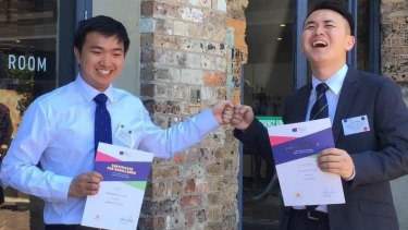 Best friends Stanley Luk and Chuyi Wang celebrate placing first in the Mathematics Extension 2 and equal first in English (Advanced) respectively.