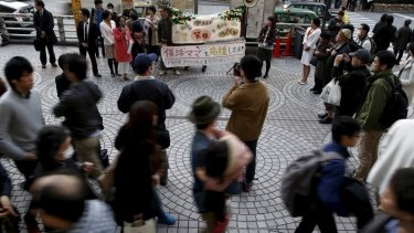 A nursery teacher speaks during a rally in support of mothers and fathers whose children failed to secure daycare places in Tokyo.