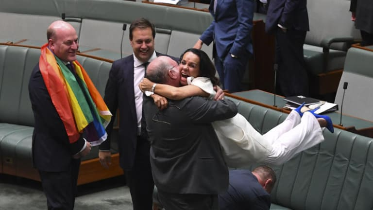 Liberal MP Warren Entsch hugs Labor MP Linda Burney as they celebrate the passing of the Marriage Amendment Bill in the House of Representatives.