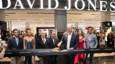 Chief executive David Thomas (right) cuts the ribbon at the recent Wollongong Central Opening with a new-look David Jones store.