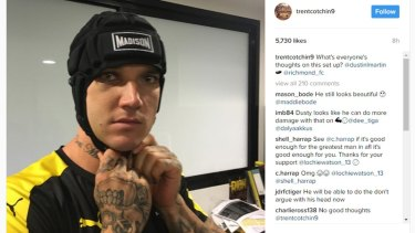The Tigers' Dustin Martin tries out a helmet this week after suffering a fractured cheekbone last round.
