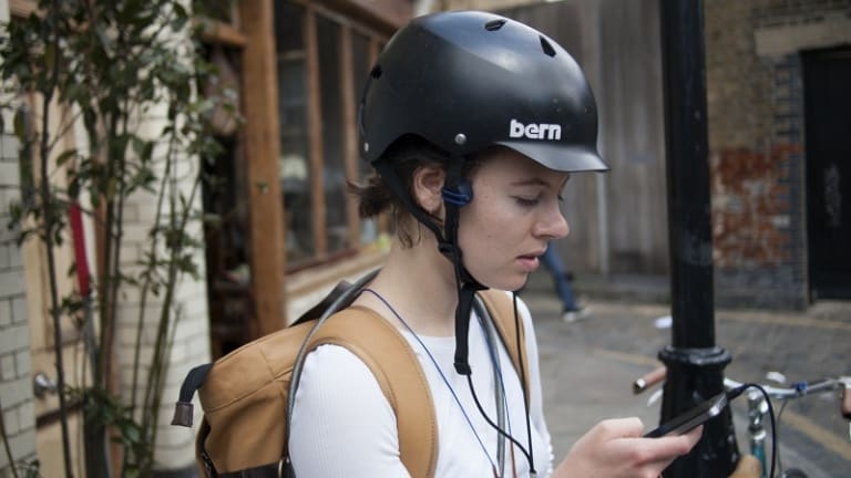 Bone-conducting headphones enable cyclists to hear traffic noises while listening to music.
