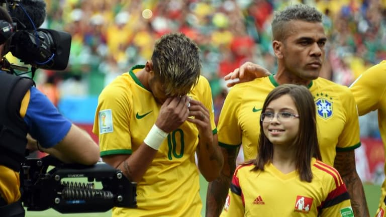 Neymar sheds a tear during the playing of the Brazilian anthem.