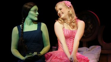 Lucy Durack (right) as Glinda in the stage musical, Wicked.