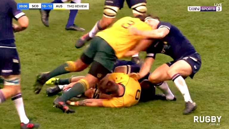 Red card offence: Sekope Kepu charges into the breakdown.