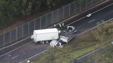 A two-truck crash blocks the westbound lanes on the Warrego Highway at Brassall.
