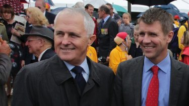Malcolm Turnbull with Mike Baird at Coogee Beach last year.