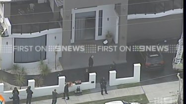 Police raiding properties in western Sydney on Wednesday morning.