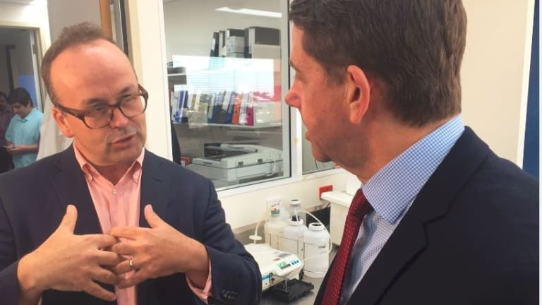 Prince Charles Hospital bionic heart and lung expert Professor John Fraser speaks with Health Minister Cameron Dick.