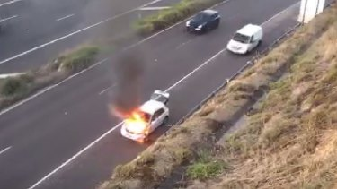The car on fire on the Eastern Freeway.