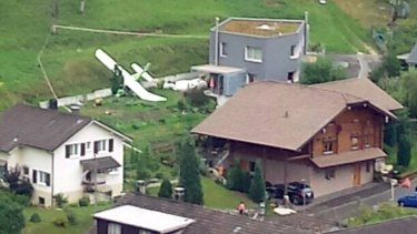 One of two planes which crashed during an air show is seen in the village of Dittingen, Switzerland.