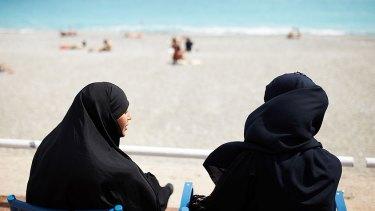 Two Muslim women soak up the sun in Nice.