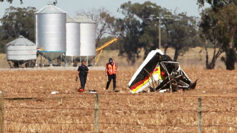 Investigators inspect the damaged aircraft in a field at Yarrawonga on Monday morning.