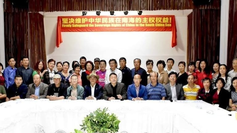 A meeting in Sydney of the Chinese patriotic association Australian Action Committee for Peace and Justice. The banner asserts China's claim to the South China Sea.