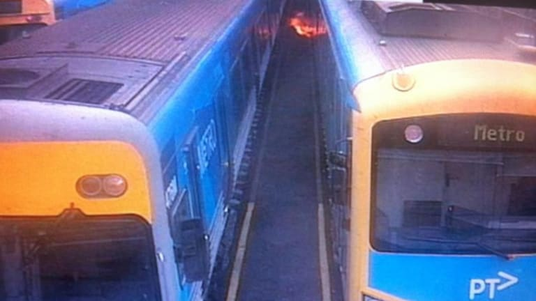 Flames shoot from a train  caused by an electrical fault. The fire did not spread but three trains have been pulled out of service.