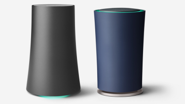 Google's OnHub routers by Asus (left) and TP-Link (right).