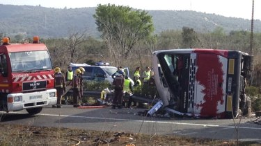 Emergency services at the scene of a bus crash that killed more than a dozen students in Spain on Sunday.