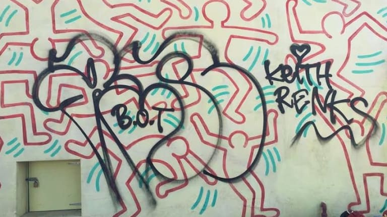 The current graffiti on Keith Haring's mural.