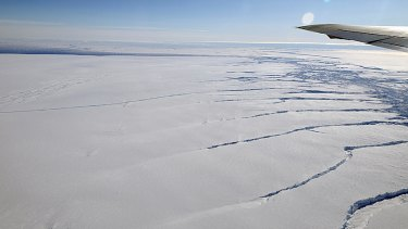 Great rifts are visible beneath the wing of a NASA aircraft flying over a glacier feeding the Amundsen Sea.