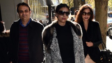 Pankaj Oswal (left) and his wife Radhika (right) and daughter Vasundhara leave court in Melbourne: There is little doubt it was the bank that blinked first.