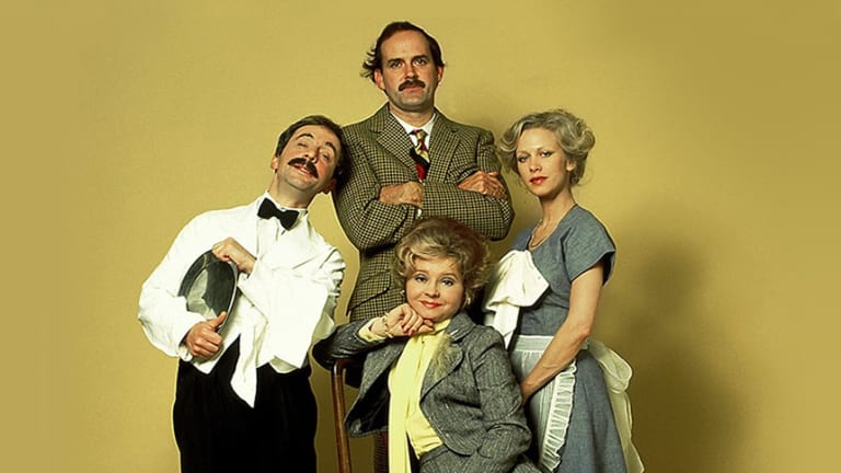 The cast of the original Fawlty Towers (left to right): Andrew Sachs as Manuel, John Cleese as Basil Fawlty, Prunella Scales as Sybil Fawlty and Connie Booth as Polly Shearman.