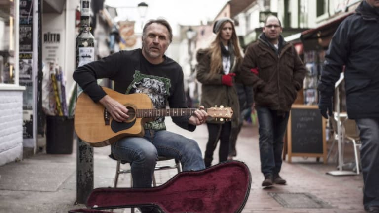 Neil Brooks, busking on the London streets in 2013.