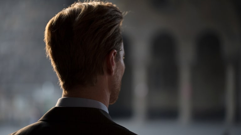 Back view of a young Caucasian businessman.