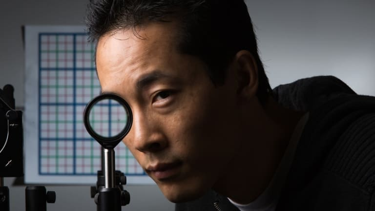 Doctoral student Joseph Choi demonstrates a multidirectional 'perfect paraxial' cloak using 4 lenses.