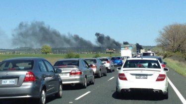 Traffic was backed up on both sides of the Federal Highway after a truck caught fire.