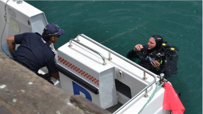 A police diver at Brennan Wharf in Port Lincoln.