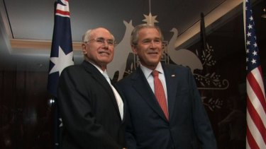 Then-Prime Minister John Howard greets then-US President George W Bush in his Sydney office in 2007.