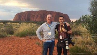 Michael Gordon on assignment with photographer Alex Ellinghausen in Uluru in 2017.