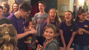 Mia with the cast of Once Upon a Mattress singing her happy birthday.