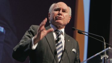 """Former prime minister John Howard says the 2014 budget will hurt battlers but he insists it is not the end of the """"fair go""""."""