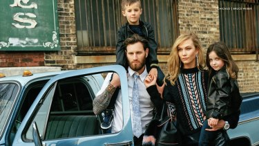 "Karlie Kloss, 23, is portrayed as a young mother in Versace's controversial ""Chicago"" fall campaign."