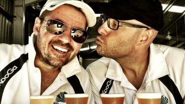Scott Sullivan (L) and Ian Davis (R) sharing a beer during their 2013 trip.