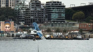 A crane has collapsed into Sydney Harbour near the iconic Luna Park.
