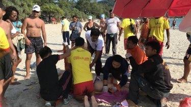 Lifesavers try to save Victorian tourist Emily Jayne Collie on Phuket's Karen Beach.