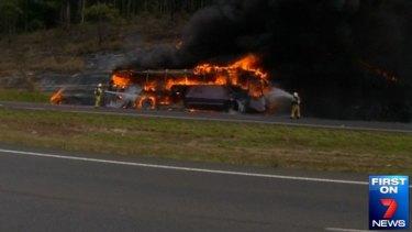 Firefighters battle a school bus blaze north of Brisbane.