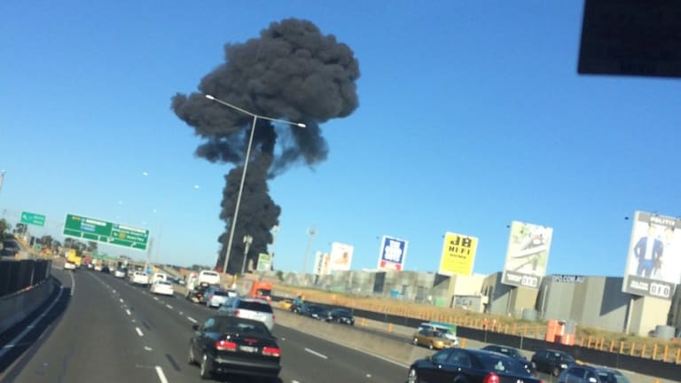 A large plume of black smoke can be seen near the DFO in Essendon.