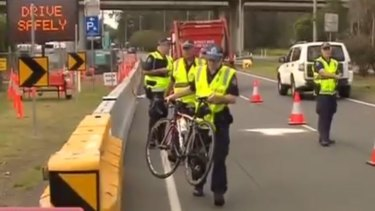 Police at the scene of an accident at Deagon in which a cyclist was knocked off a bike.
