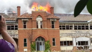 The former boys' home St John's burned on Wednesday, but fire investigators say the blaze is not suspicious.