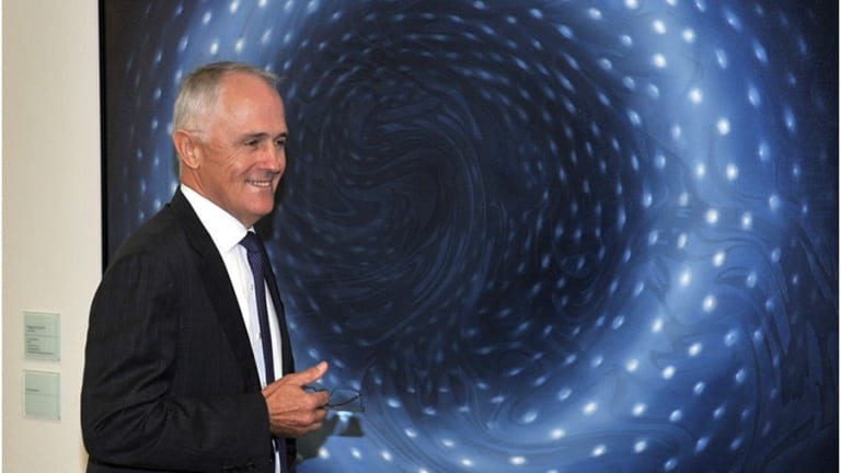 """Malcolm Turnbull in front of Megan Walch's artwork, """"Blue Donut"""", at Parliament House."""