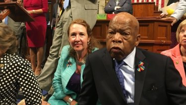 Democrat members of Congress including Representative John Lewis, centre, and Elizabeth Esty participate in the sit-down protest.
