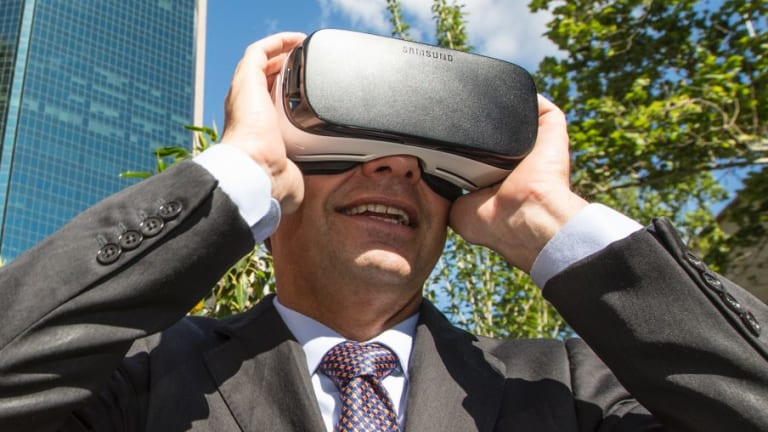 The Assistant Minister for Cities and Digital Transformation, Angus Taylor, looks at a virtual reality version of Circular Quay in 2037 at the Future Street Project.