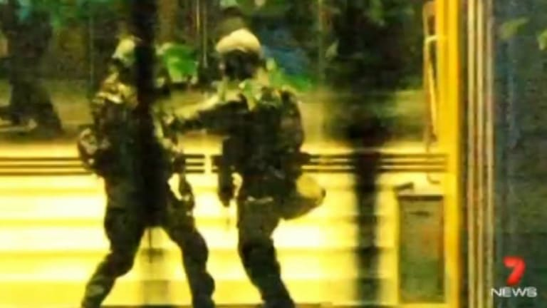 Police towards the siege's end: Parker had three cameras trained on the cafe.