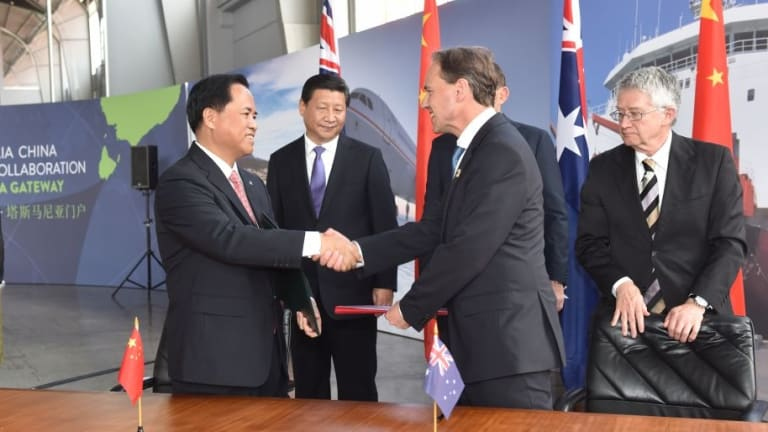 Liu Cigui of China's State Oceanic Administration and Environment Minister Greg Hunt shake hands after signing a Memorandum of Understanding on Antarctic collaboration.